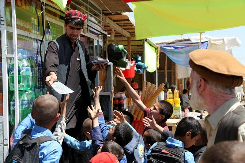 800px-Afghan_children_request_leaflets_in_a_Bagram_bazaar.jpg