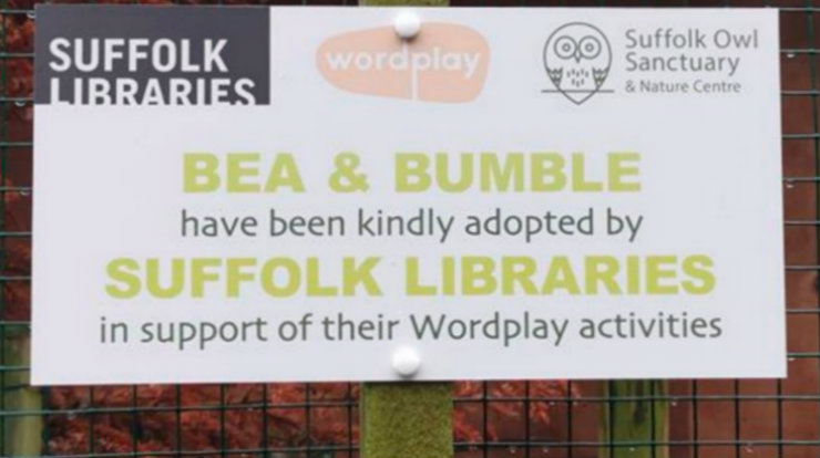 Plaque marking Suffolk Libraries' adoption of Ural owls Bea and Bumble at Suffolk Owl Sanctuary