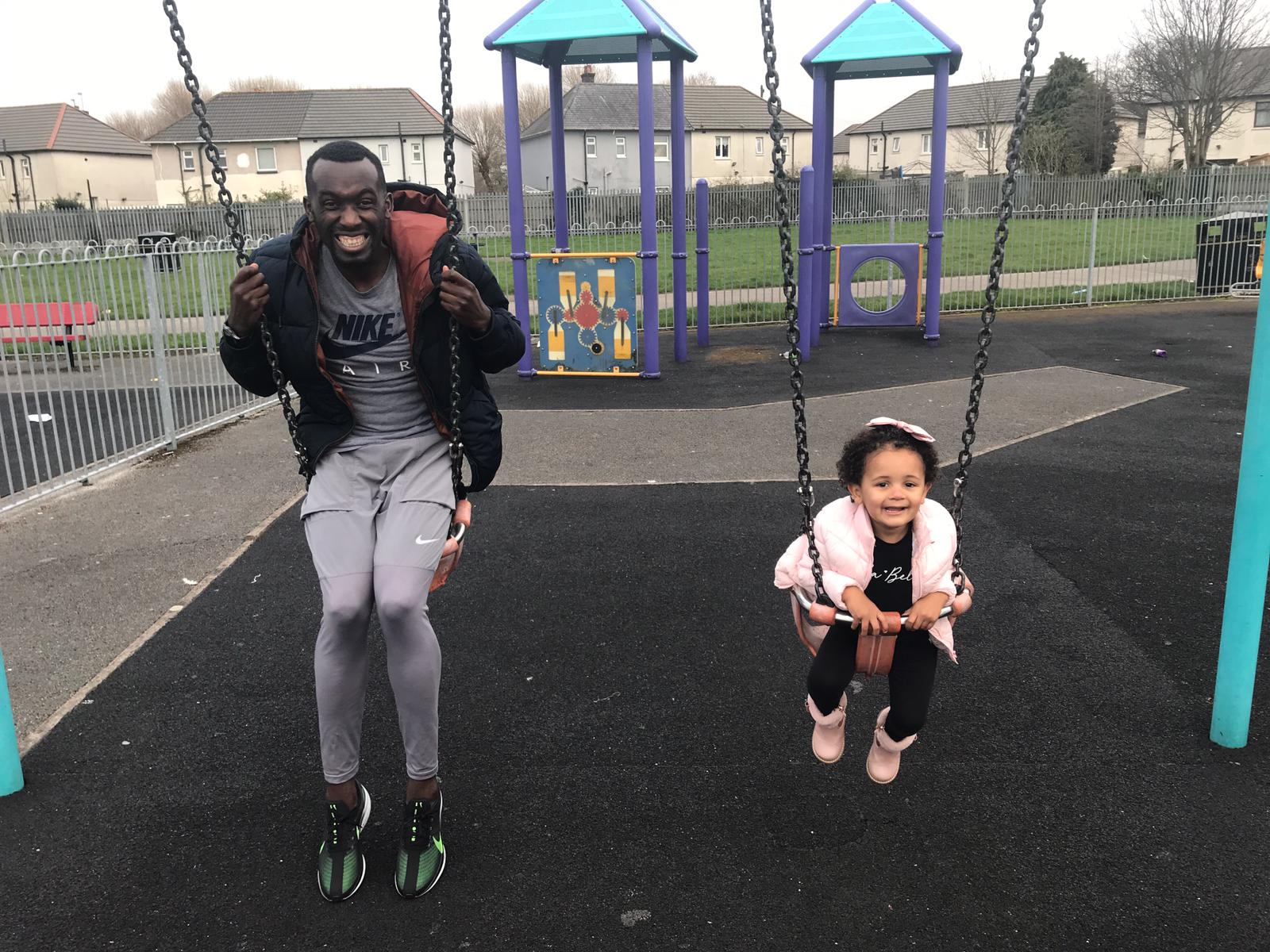 Emini on the swings with his daughter