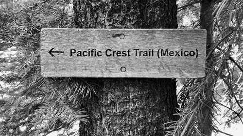 A sign on the PCT points the direction to Mexico