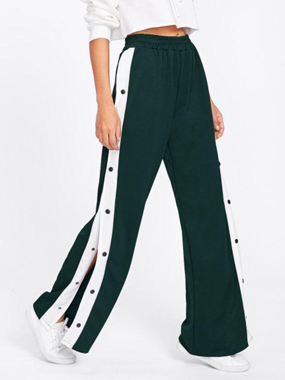 Pantalons sportwear ouvert sur les côtés et refermable par boutons pressions