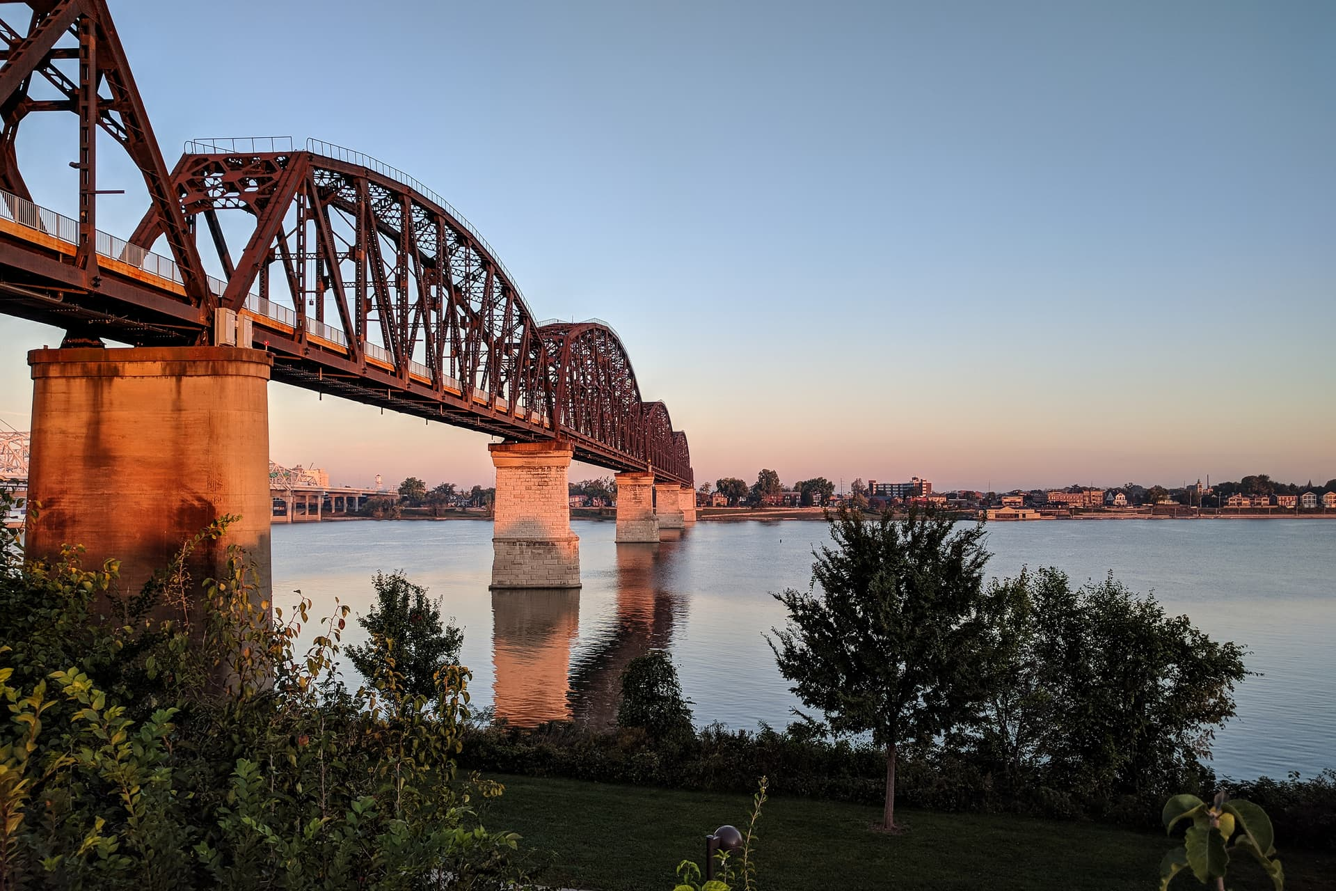 A steel foot bridge over the Ohio River, seen just after dawn.