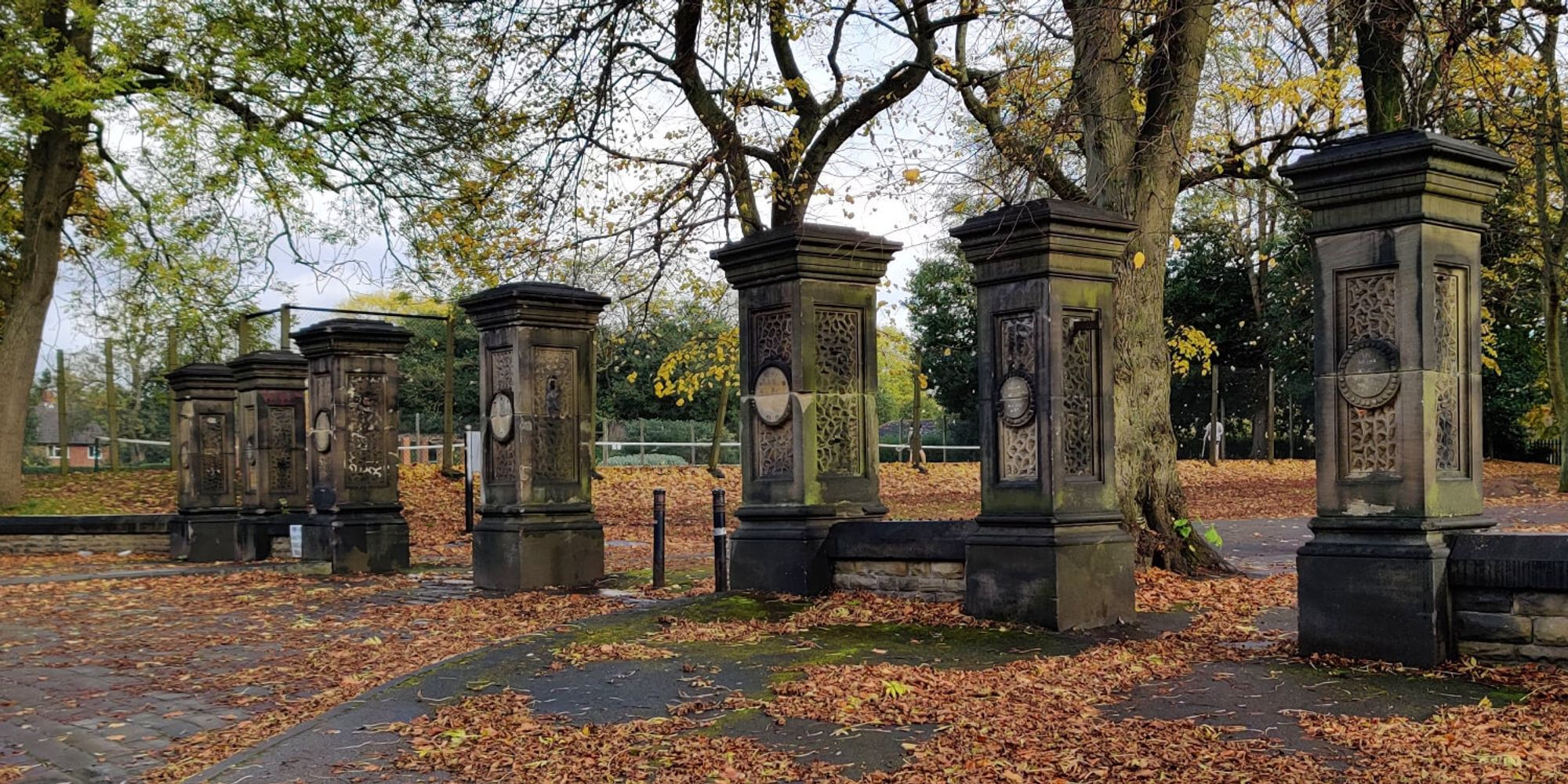 Large old stone pillars marking the entrance to Burley Park