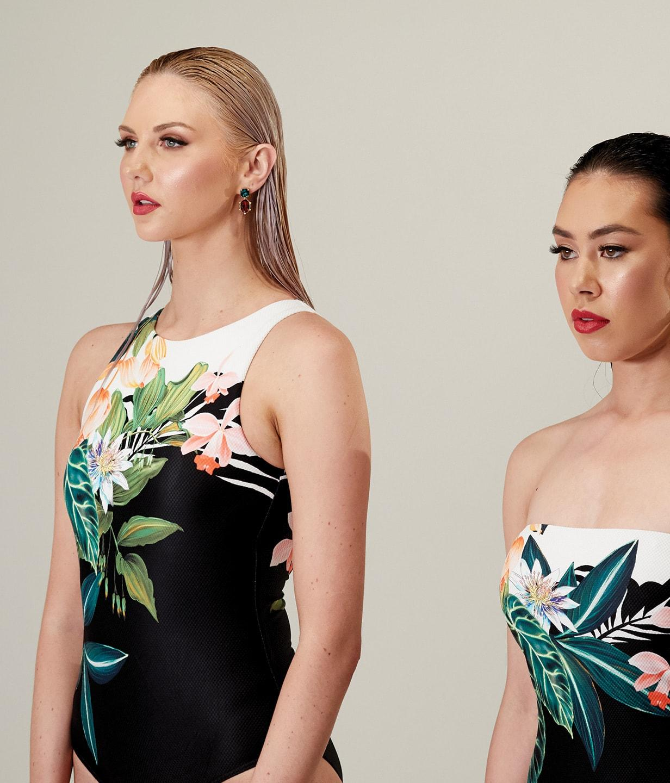 Two women posing in swimsuits
