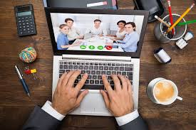Person using computer to participate in virtual meeting