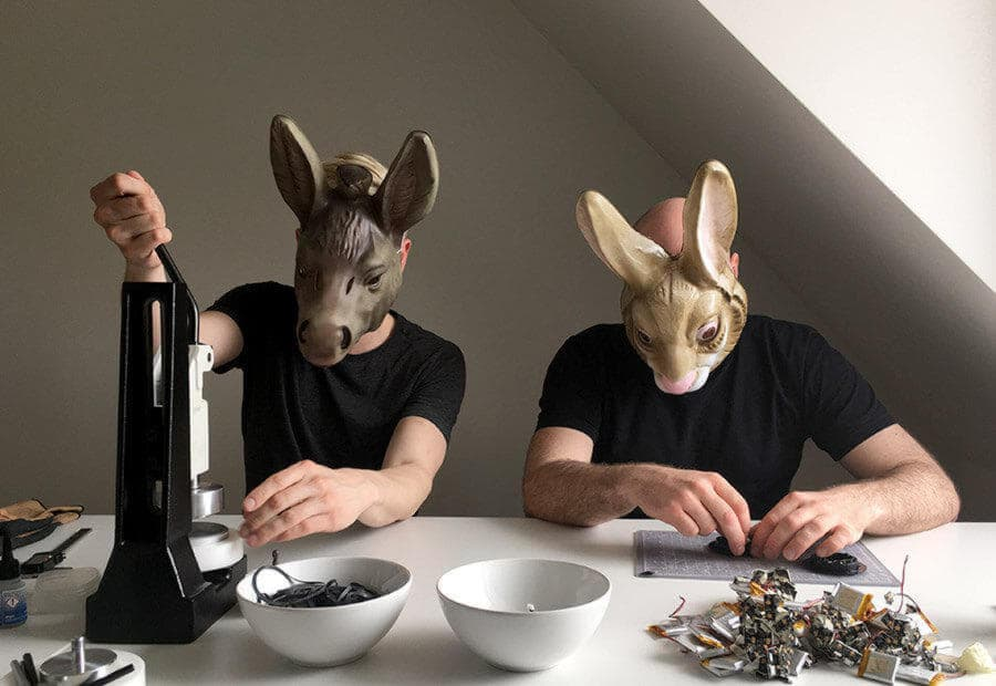 Senic team members together having lunch wearing animal masks