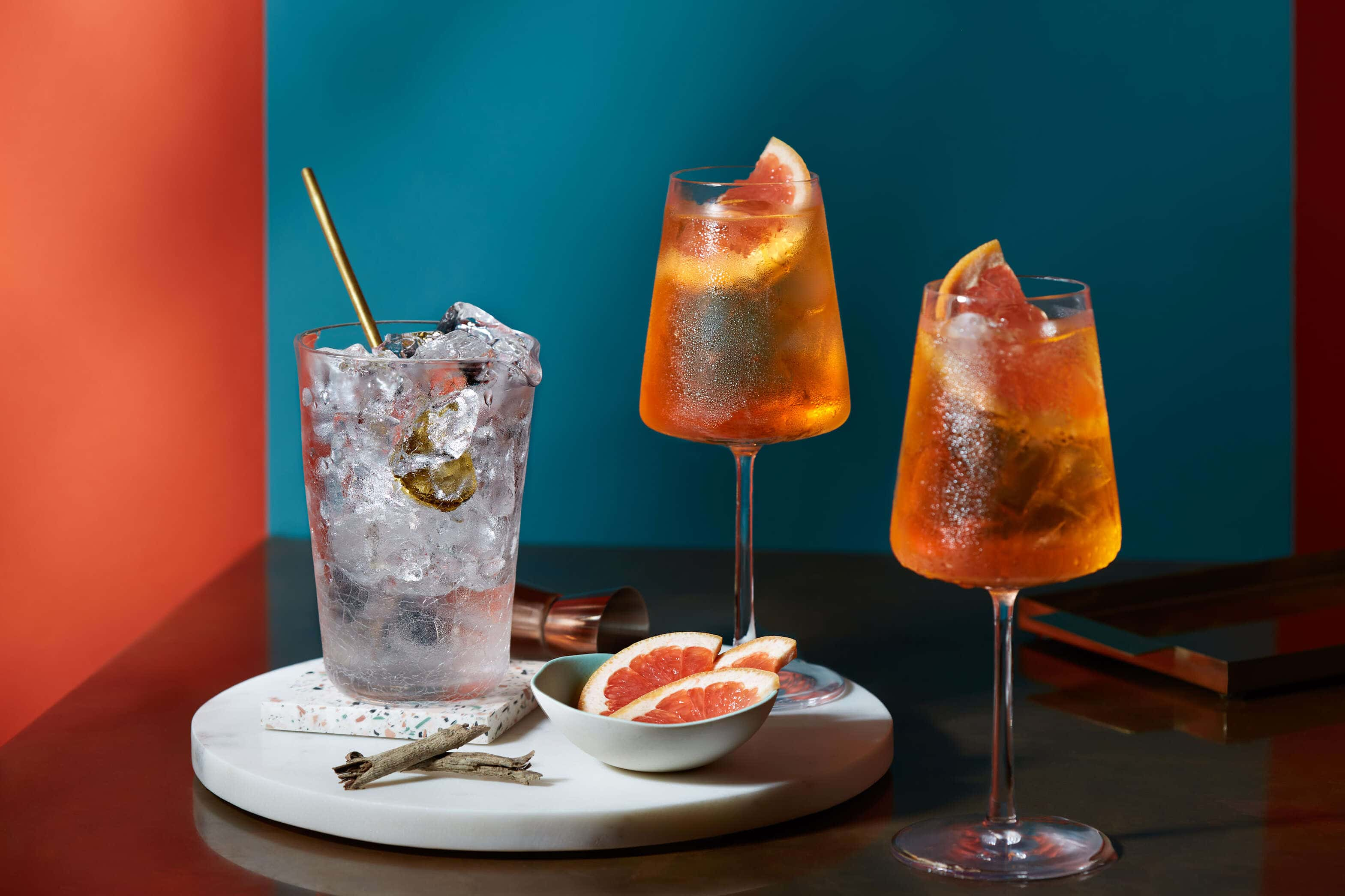 Orange cocktails with ice and garnishes