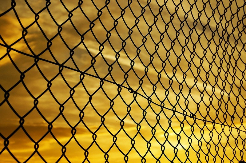 chain link fence with sky beyond