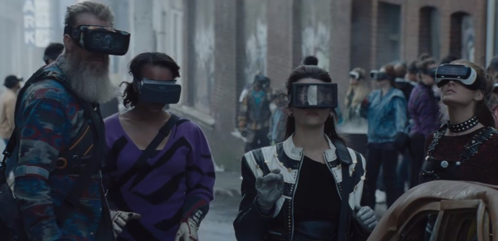 Oasis users from Ready Player One standing in the street with their headsets on.