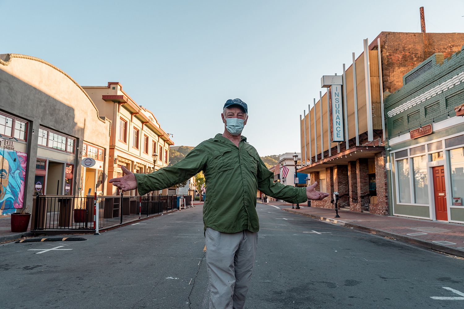 Long-time Martinez resident Ken King poses for a photo in the deserted downtown in Martinez, Calif., on Sunday, July 12, 2020.