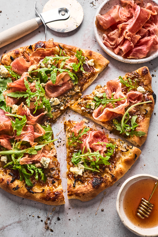 Fig Prosciutto Gorgonzola Arugula Pizza With Hot Honey