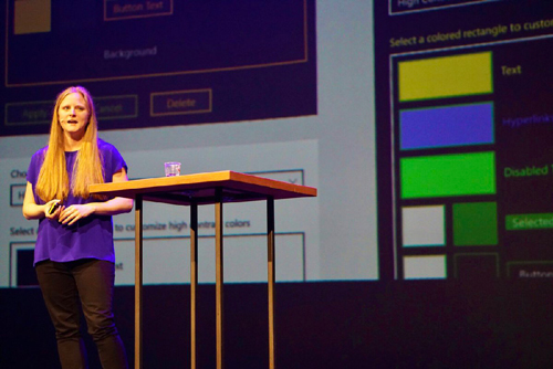 Me speaking on stage at View Source, in front of a slide showing various Windows High Contrast themes