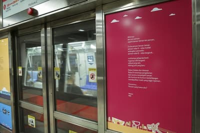A close-up of one of the poems on a MRT door.