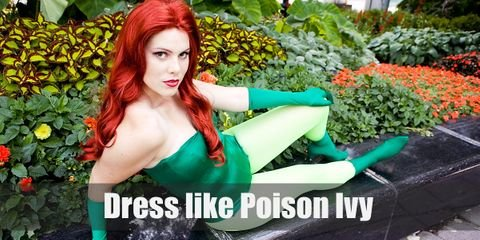 Base on her style in Batman & Robin movie, Poison Ivy has long bright red hair with bright green nails and green outfit.
