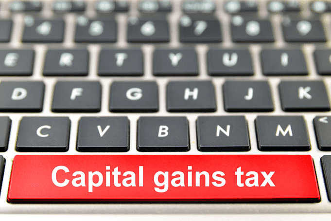 Keyboard with Capital Gains Tax written on the space bar
