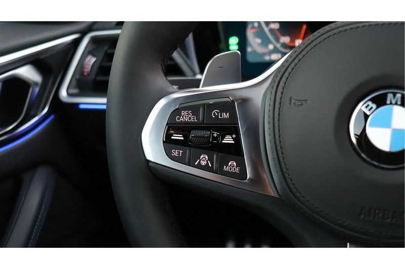 BMW 4 Serie Coupé M440i xDrive High Executive Harman/Kardon, Head Up Display, Schuifdak afbeelding 17