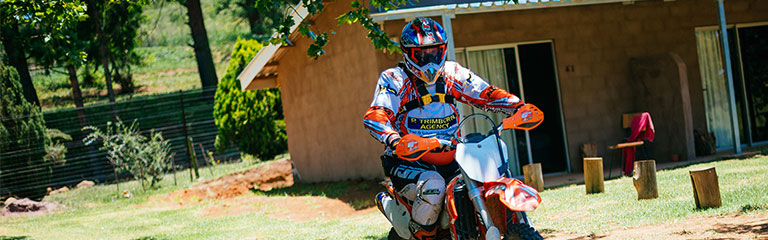 Person on an off-road motorbike.