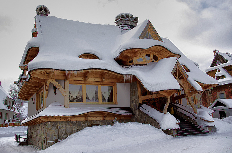 snow-covered wooden cabin in poland