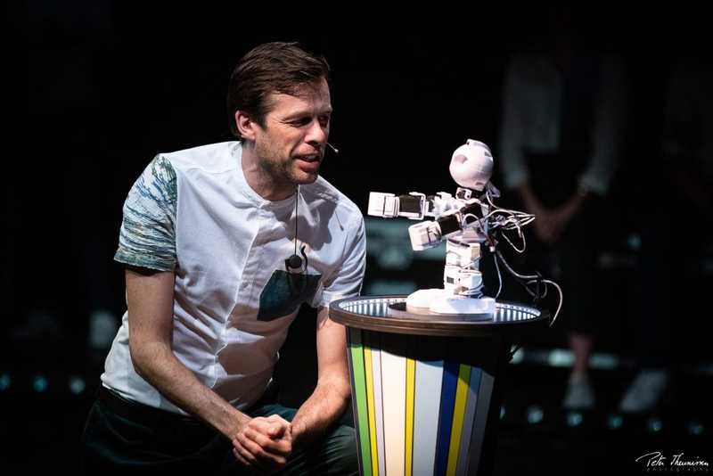 An performer improvising a scene with robot Alex