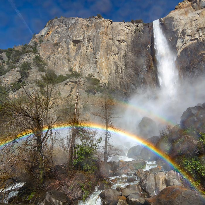 Shot from the hip with a very wet camera: a double rainbow graces Pohono (Bridalveil Fall), Yosemite National Park, CA