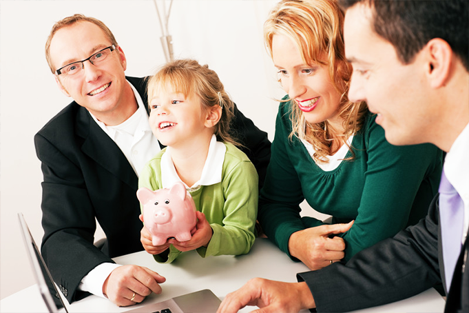 A couple and their child being shown details by a tax accountant.
