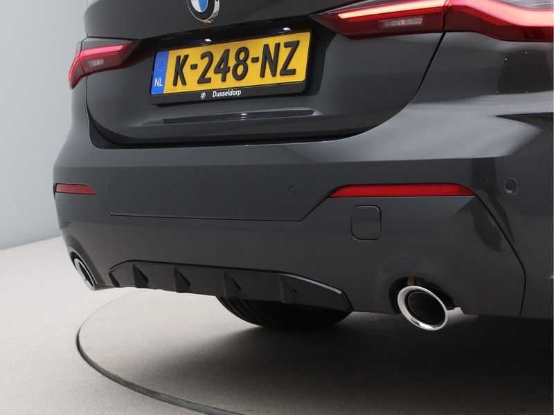BMW 4 Serie Coupé 420i High Exe M-Sport Aut. afbeelding 11