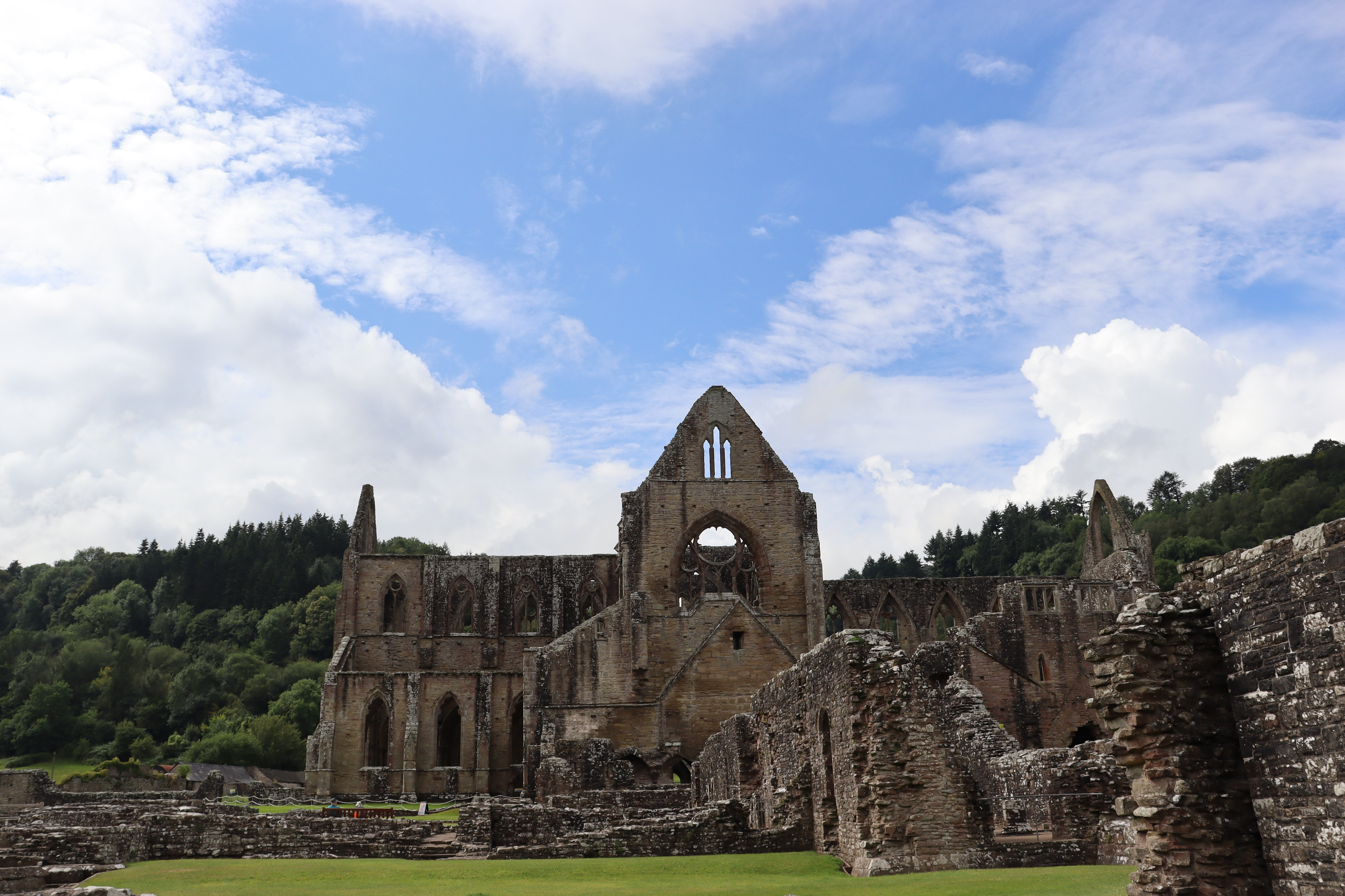 View of Tintern Abbey with ruins in the foreground.