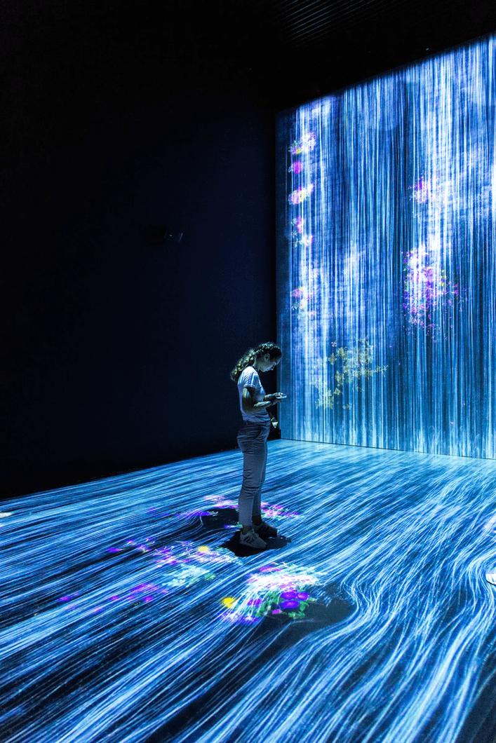 Digital lines flow around person
