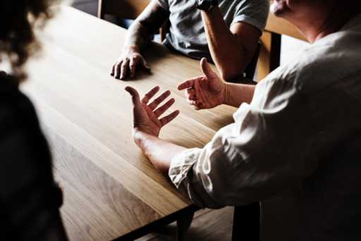Accountant, advisor, surround table with clients to work on business and strategy