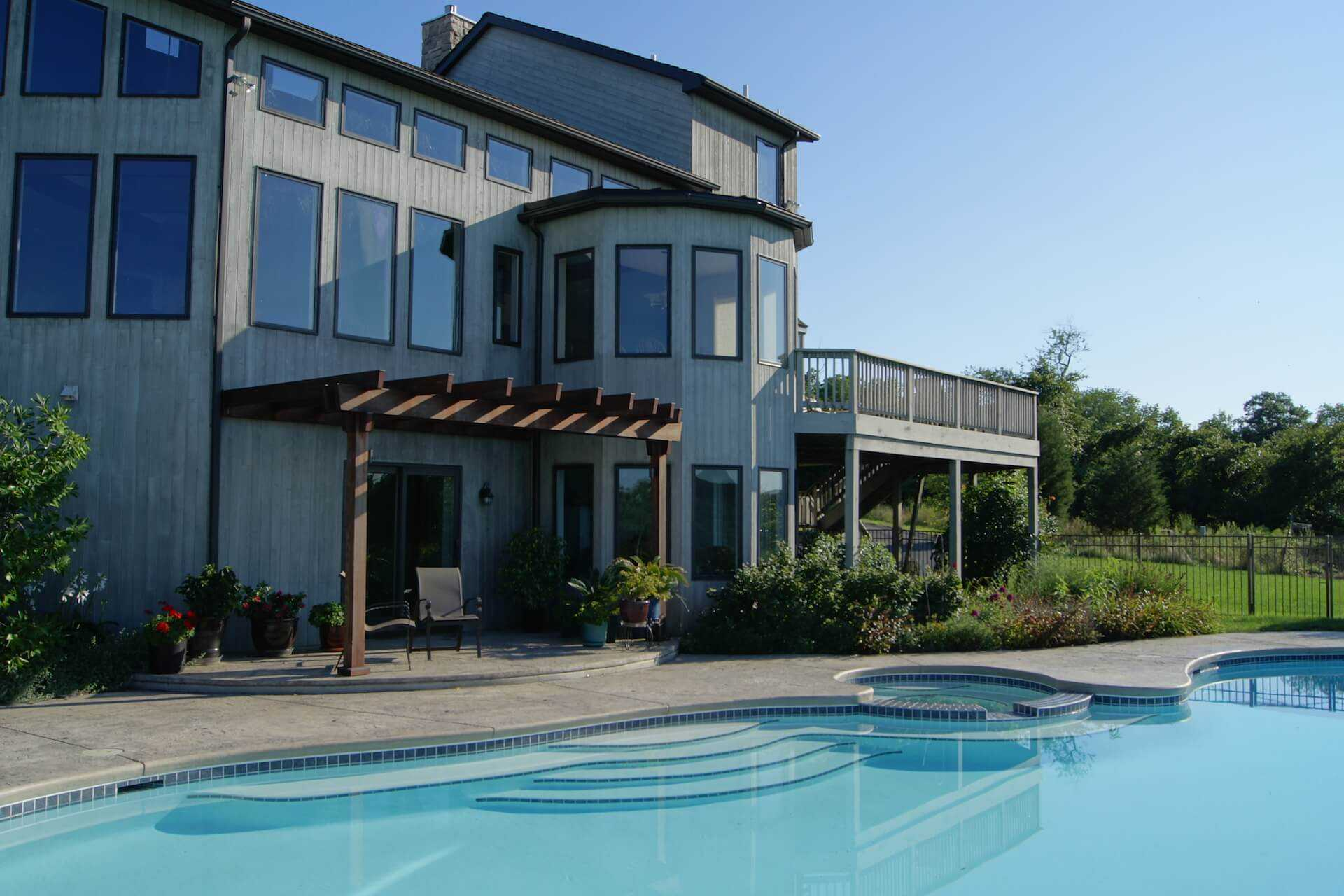 viewing the house patio behind the pool