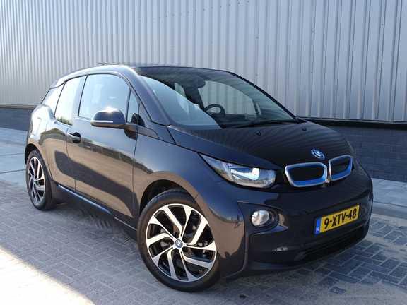 BMW i3 Basis Comfort Advance 22 kWh Marge Warmtepomp Navigatie Clima Cruise Panorama *tot 24 maanden garantie (*vraag naar de voorwaarden)