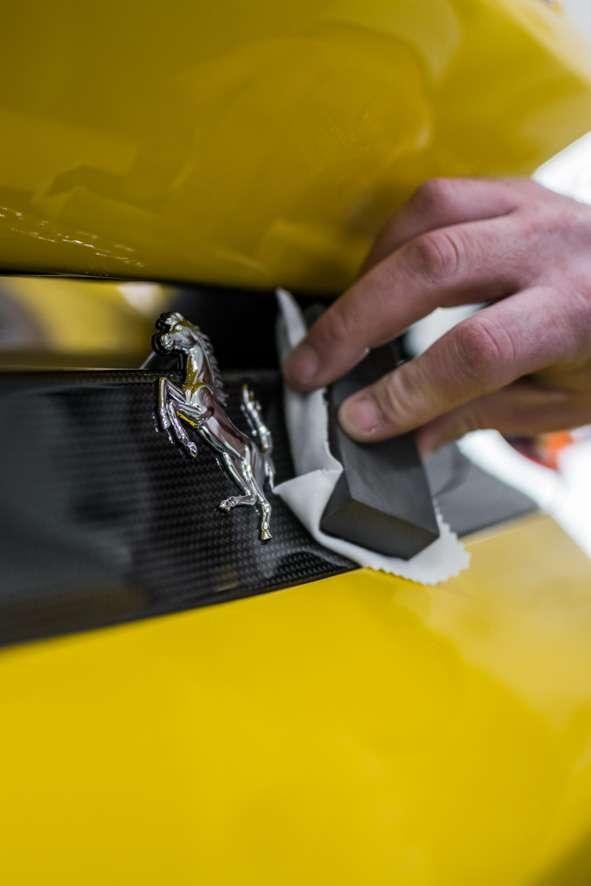 Close up shot of Kubebond ceramic coating being applied onto car yellow Ferrari 488 Pista
