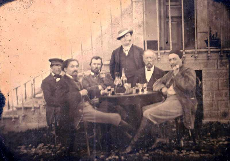 Thought to be Vincent van Gogh (third from the left, with pipe) in conversation with Paul Gauguin, Émile Bernard, Félix Jobbé-Duval. André Antoine is standing between them. Anonymous photograph, 1887. (© L'artauprésent, CC BY-SA 4.0)