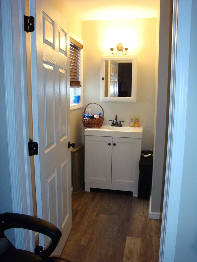 bathroom vanity before a remodel by CorHome