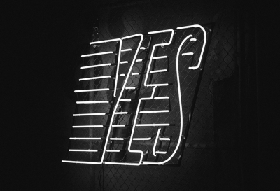 "neon sign of ""YES"""