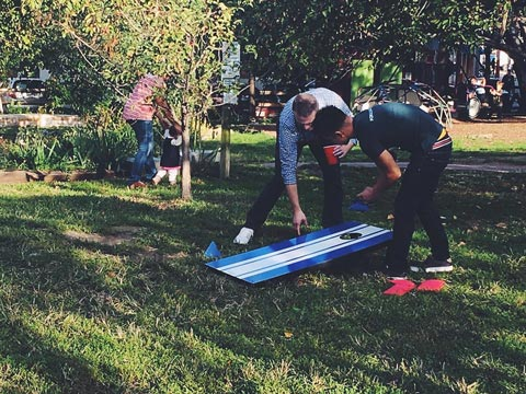O3 World team members playing yard games at team happy hour