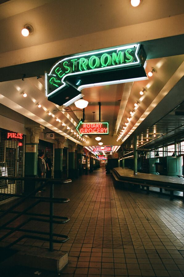 Empty hallway in the public market with neon signage