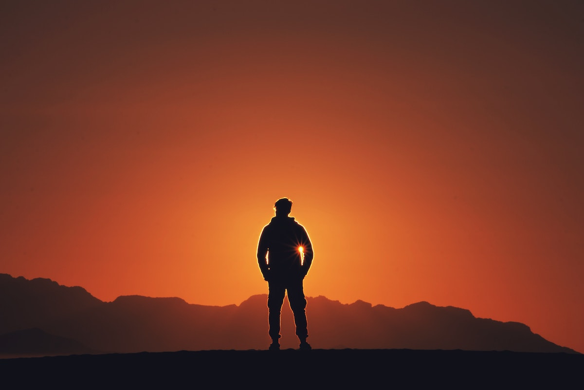 Sunrise with the shadow of a man in front of it