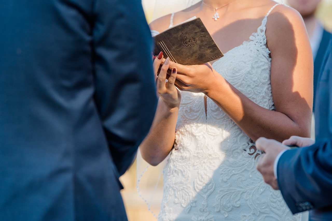 Kalika reading from her vow book during the ceremony