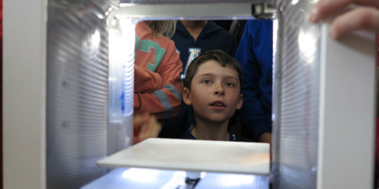 A child using a 3D printer