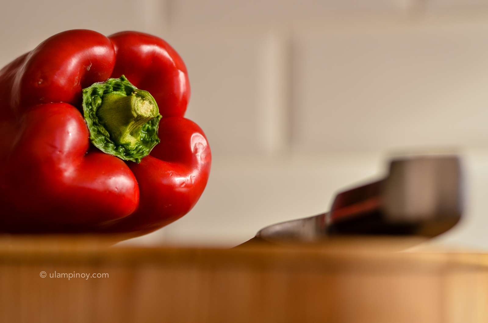 Red bell pepper on chopping board