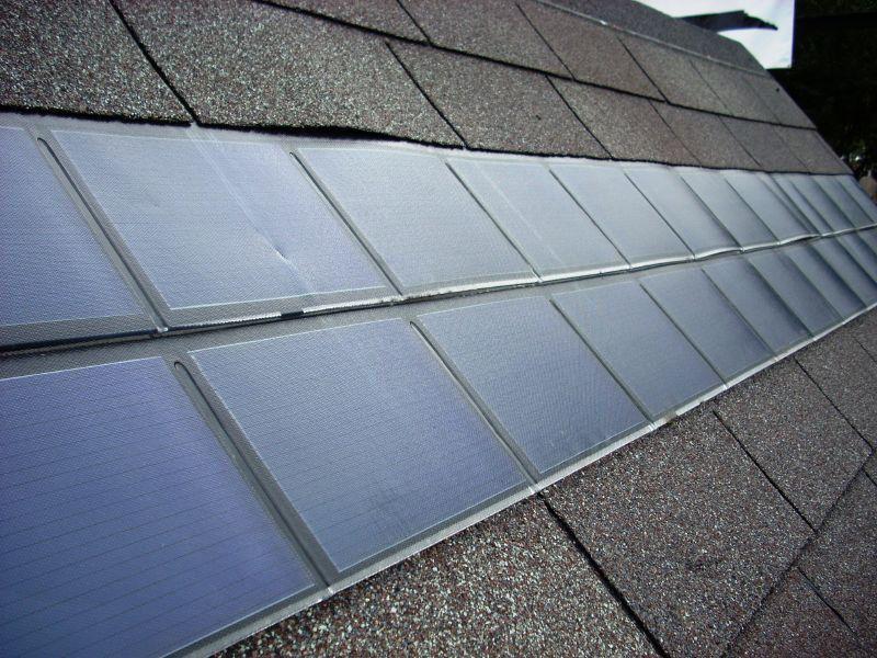 solar shingles on black tiled roof