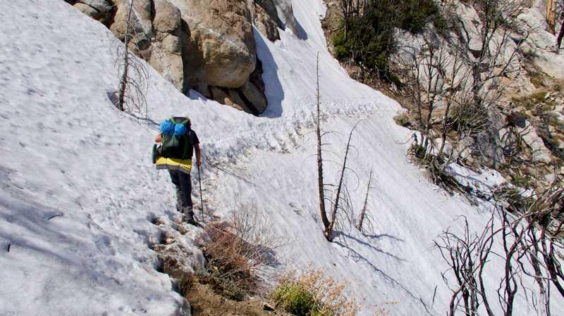 Snow traverse on steep mountain