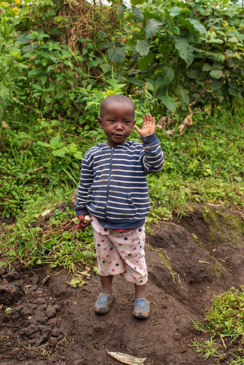 Child in Volcanoes National Park