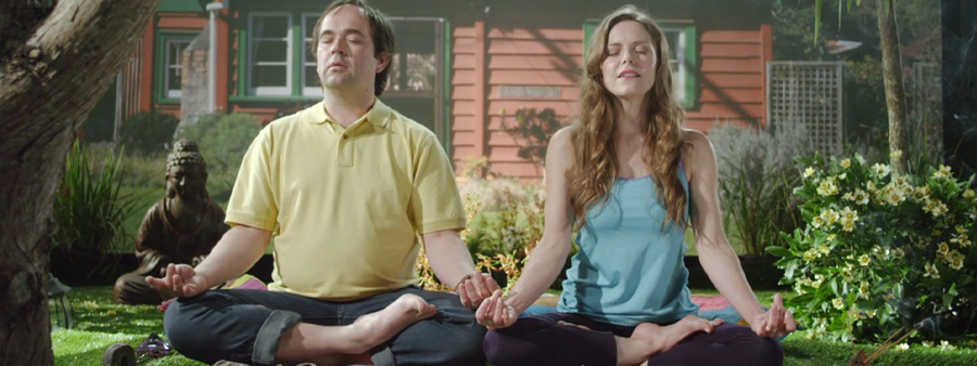Realestate campaign still of two people meditating