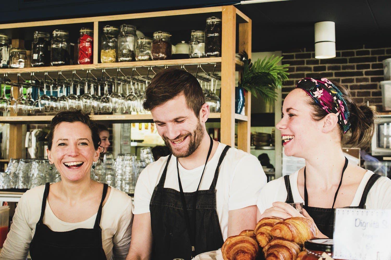 Dignita team members enjoy working at the Amsterdam restaurant and social enterprise