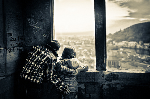 kids looking over city in abandonded building