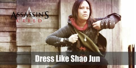Shao Jun - a fearless sword swinging assassin, wears a deep brown hooded coat with red silk trim and a mandarin collar