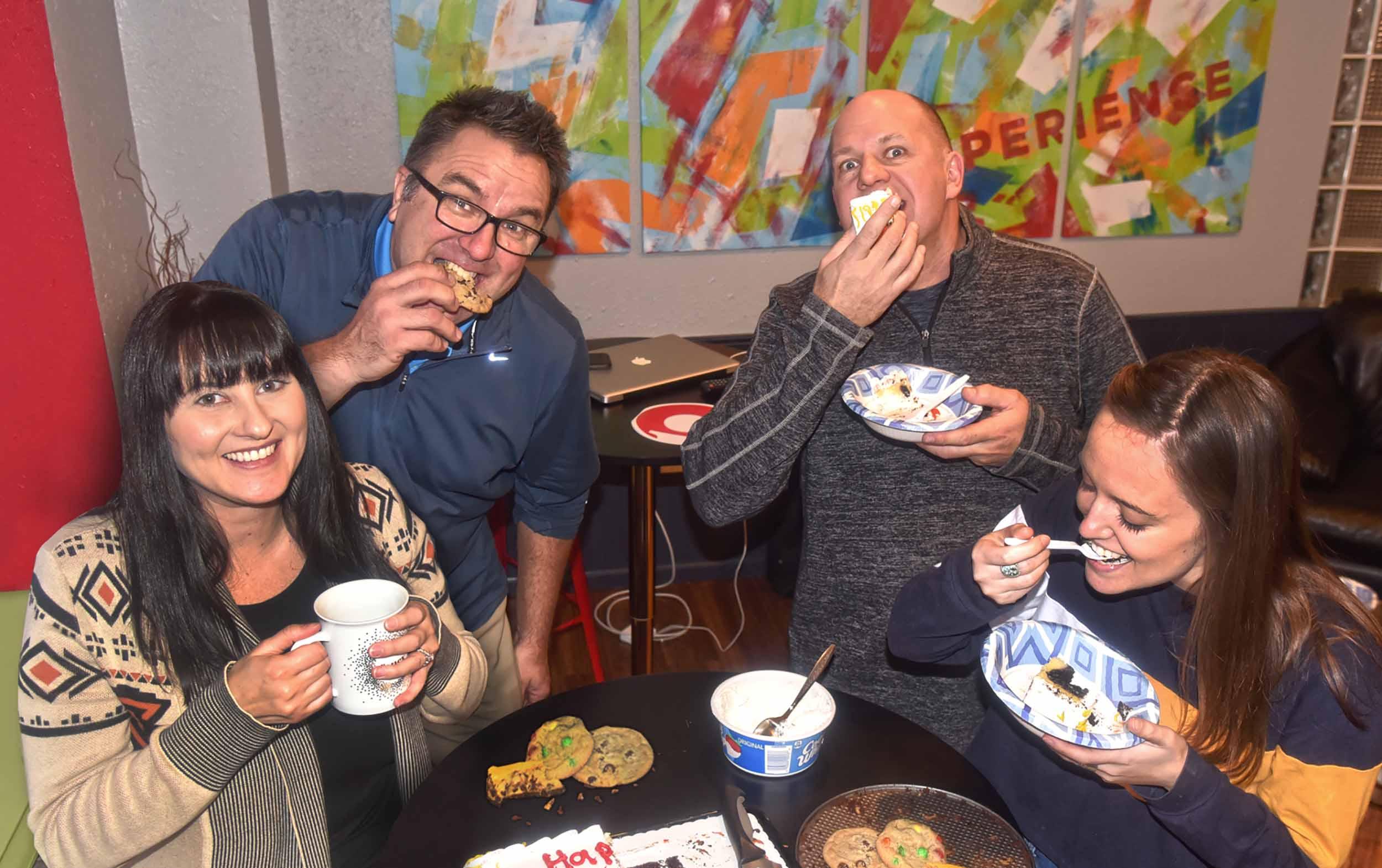 Insight Creative, Inc. employees enjoying a cake break
