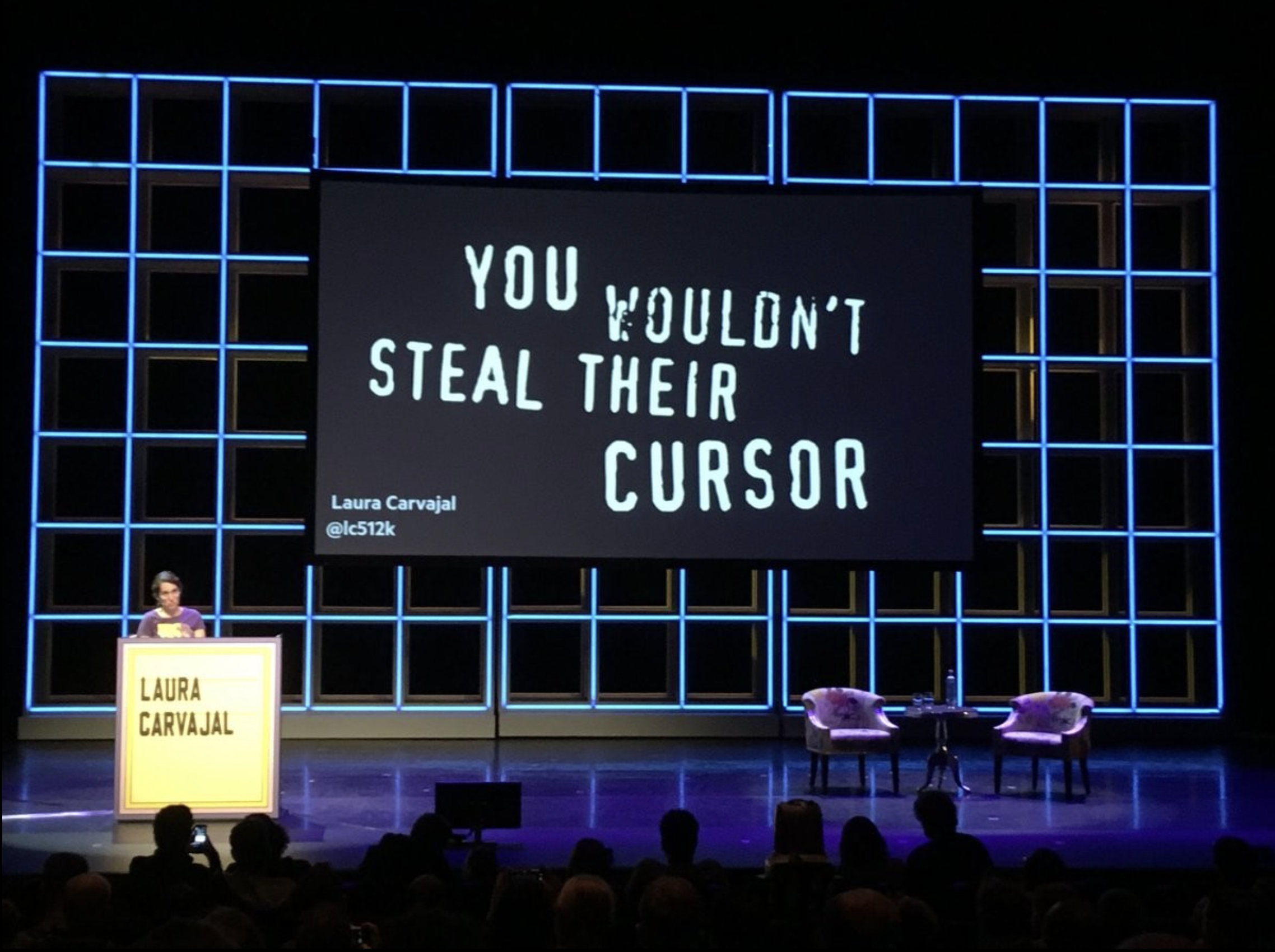 Laura Carvajal on stage at Fronteers 2018, with a slide on screen behind her that says 'You wouldn't steal their cursor'